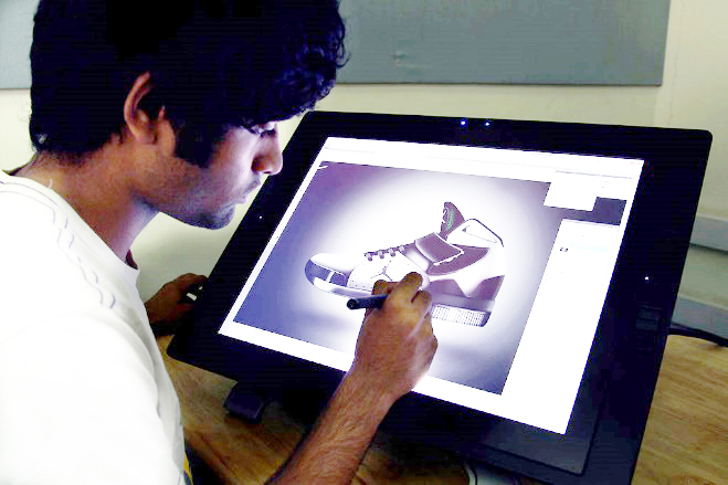 Person using a stylus on a drawing tablet