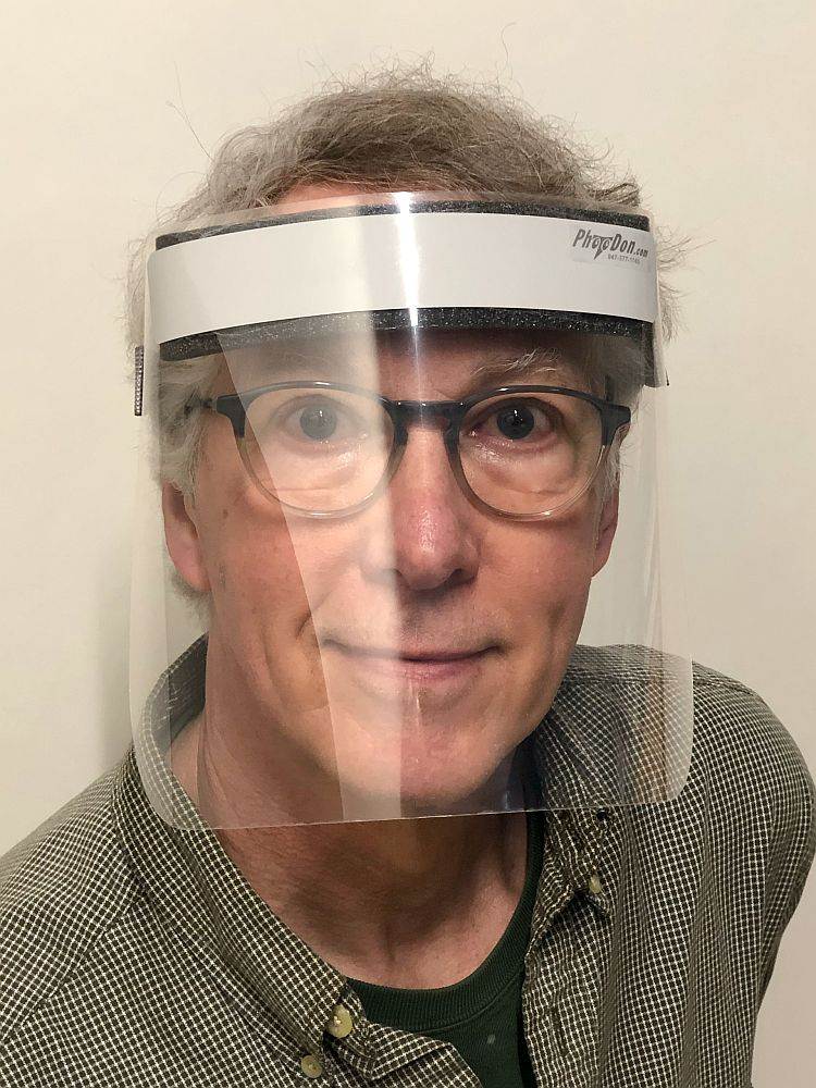 Don Basch, owner of Photodon, pictured wearing a personal protection mask he made.